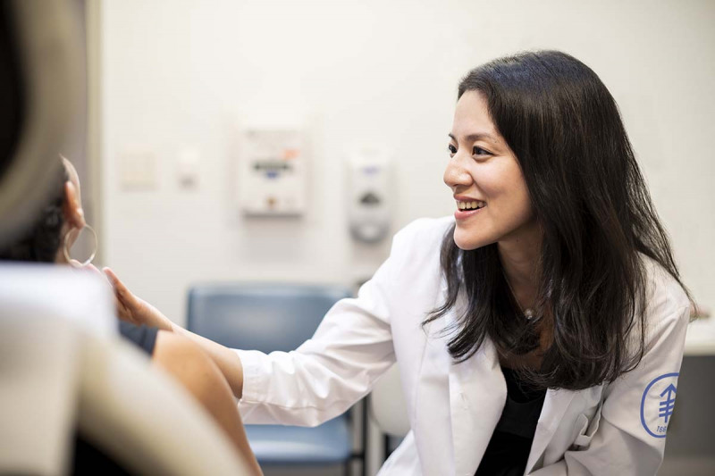 Mohs surgeon Erica Lee with a patient