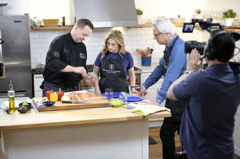 Chef Timothy Gee, MSK Executive Chef, Alicia Gould, RDN, CDN, and host, Bill Piersol, on the set of CancerSmart: In the Kitchen with MSK.