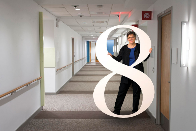 MSK director of social work Penny Damaskos, posing with a human-sized number 8