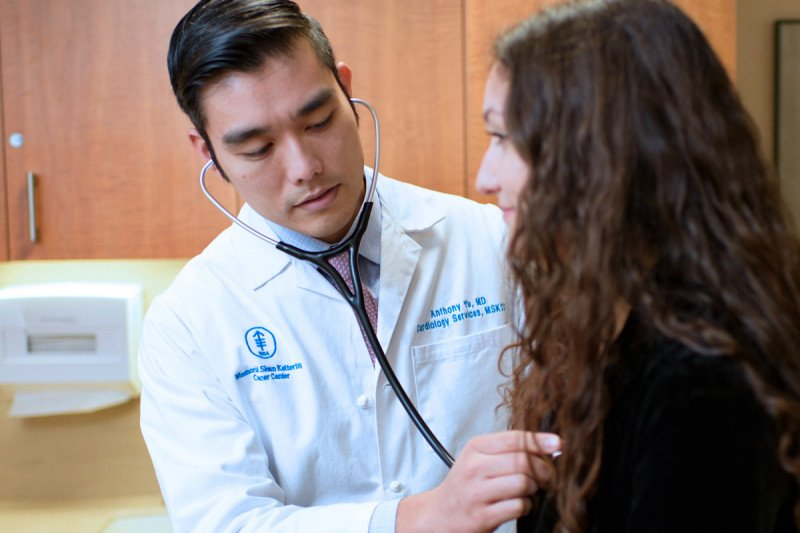 Cardiologist Anthony Yu examines a patient