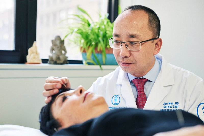 Dr. Jun Mao with patient