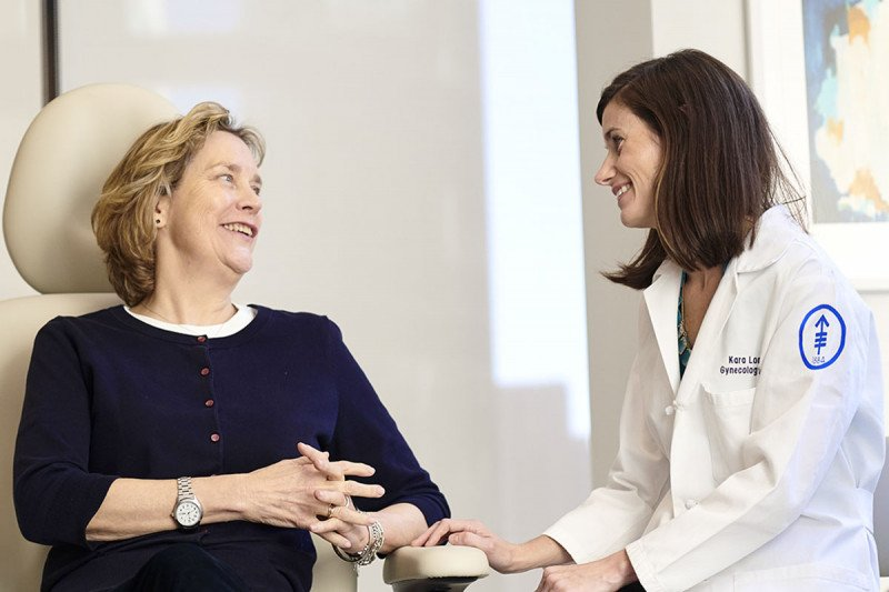 Dr. Long Roche with a patient