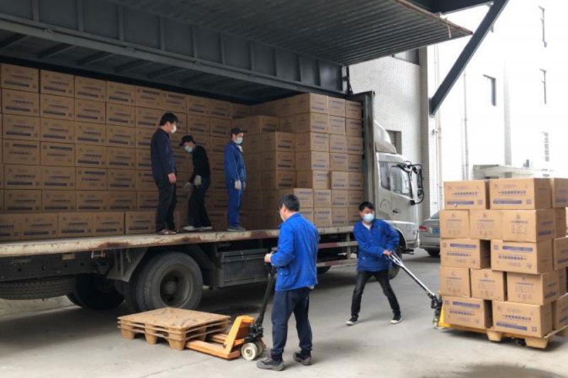 Workers loading boxes onto a truck