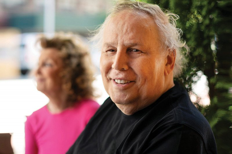 A man in his 70s (prostate cancer patient) smiling for camera