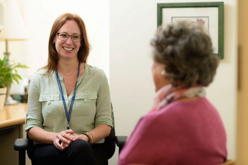 A social worker at MSK listens to a patient