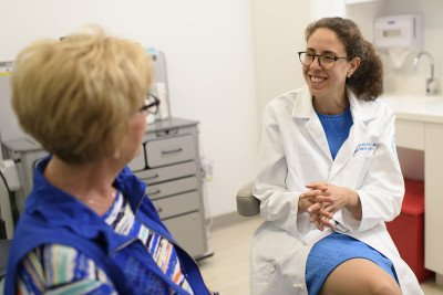 Head and Neck Cancer Surgeon, Jennifer Cracchiolo, talking to a patient.