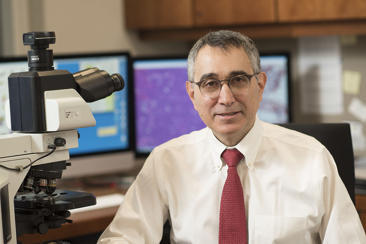 MSK pathologists — including Ahmet Dogan —review thousands of samples each year and generate more than 170,000 diagnostic reports.