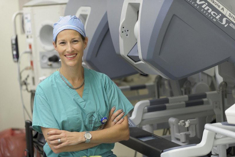 MSK surgeon Elizabeth Jewell stands near a surgical machine used for cervical cancer treatment