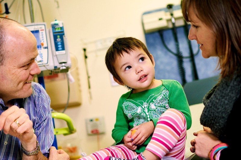 Pediatric neuroblastoma expert Stephen Roberts meets with a young patient