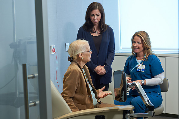 Woman preparing for chemotherapy with nurse and caregiver at Memorial Sloan Kettering Westchester