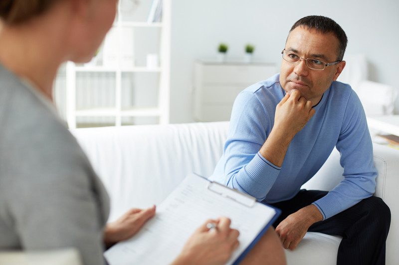 man talking with therapist