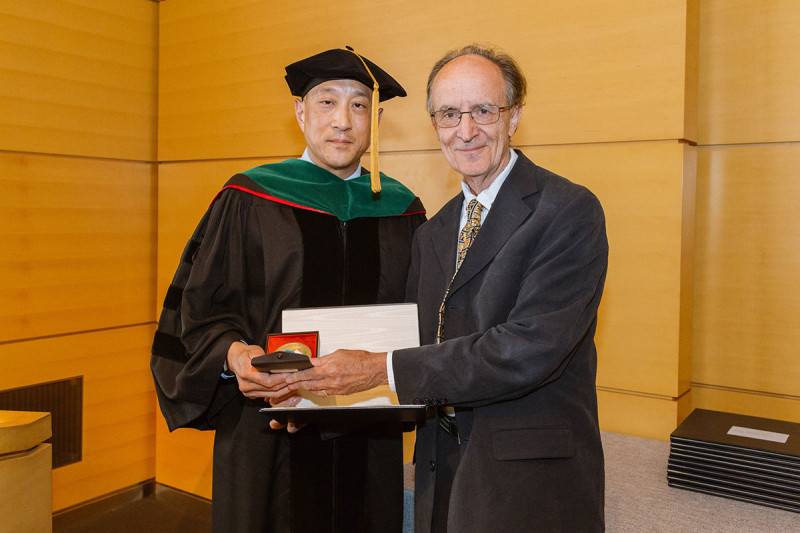 Andrew Kung with pediatric leukemia researcher Melvyn Greaves