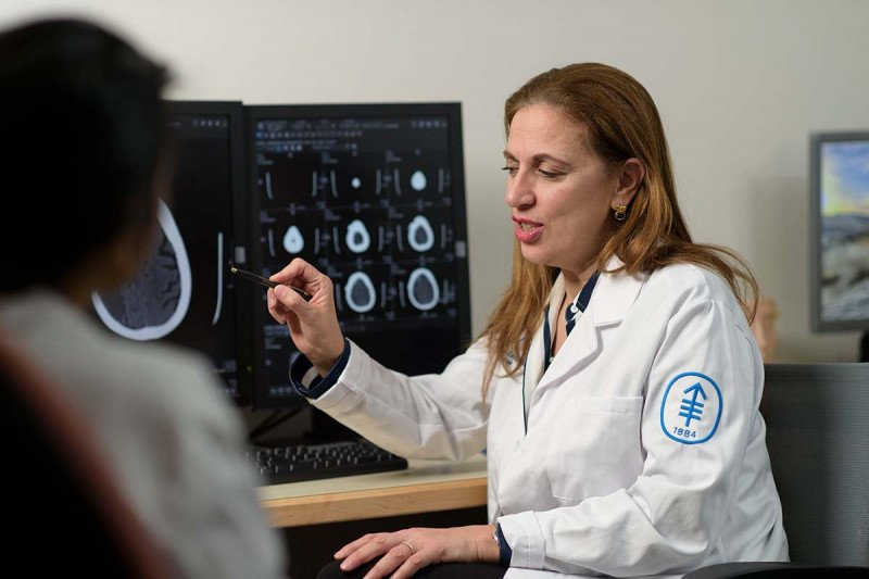 MSK Neurosurgeon, Viviane Tabar who specializes in treating patients with brain tumors, analyzes a brain scan.