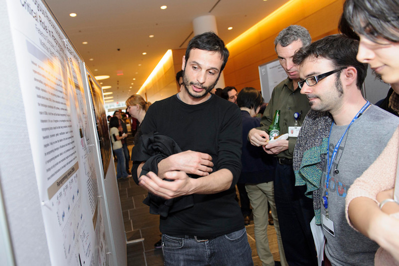 """Federico Gonzalez Grassi (left) of the Sloan Kettering Institute's Developmental Biology Program and the Center for Stem Cell Biology NYSTEM Trainings Grant discusses """"Homologous Recombination DNA Repair Genes Play a Critical Role in Reprogramming to a Pluripotent State."""""""
