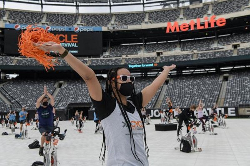 Participants rode at Cycle for Survival's first ever socially distant outdoor ride at MetLife Stadium in New Jersey.