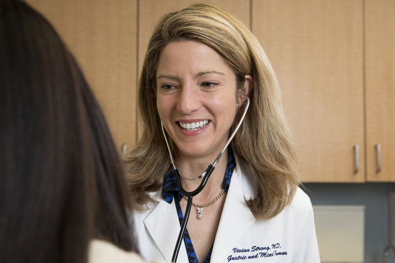 Smiling female doctor talking to patient.