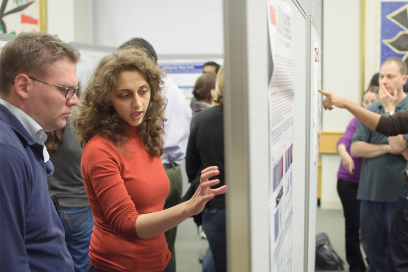 Memorial Sloan Kettering researchers discussing their work at the poster session and reception