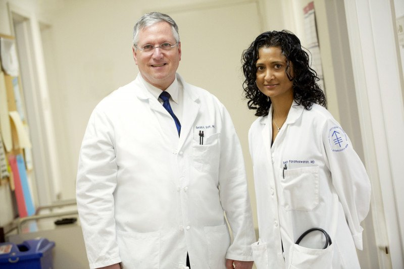 MSK hematologists Gerald Soff and Rekha Parameswaran stand together in lab coats.